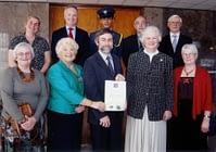 Committee members receiving the certificate